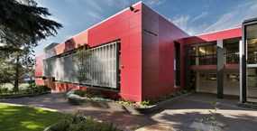 A large modern red school building