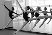 Ballet Girls leaping through the air with arms out