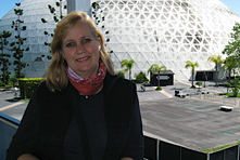 Delma co-founder standing in front of a large museum