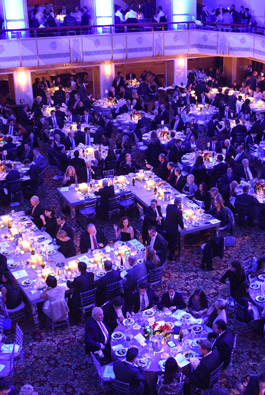 People at a tabled fundraising ball