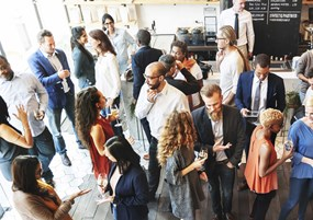 Group of people networking at event