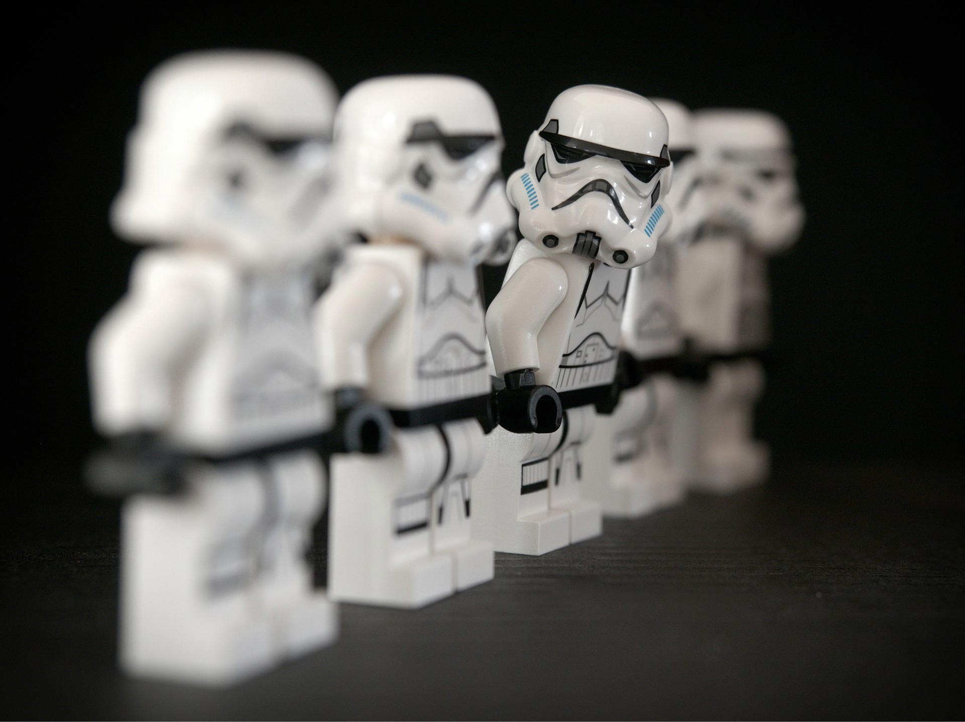 Row of storm trooper toys