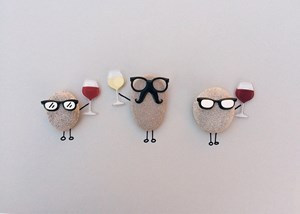Funny potatoes with glasses holding wine