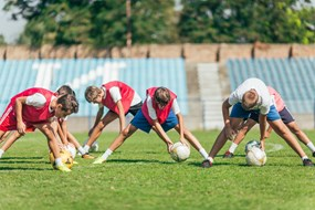 Boys soccer training group drill