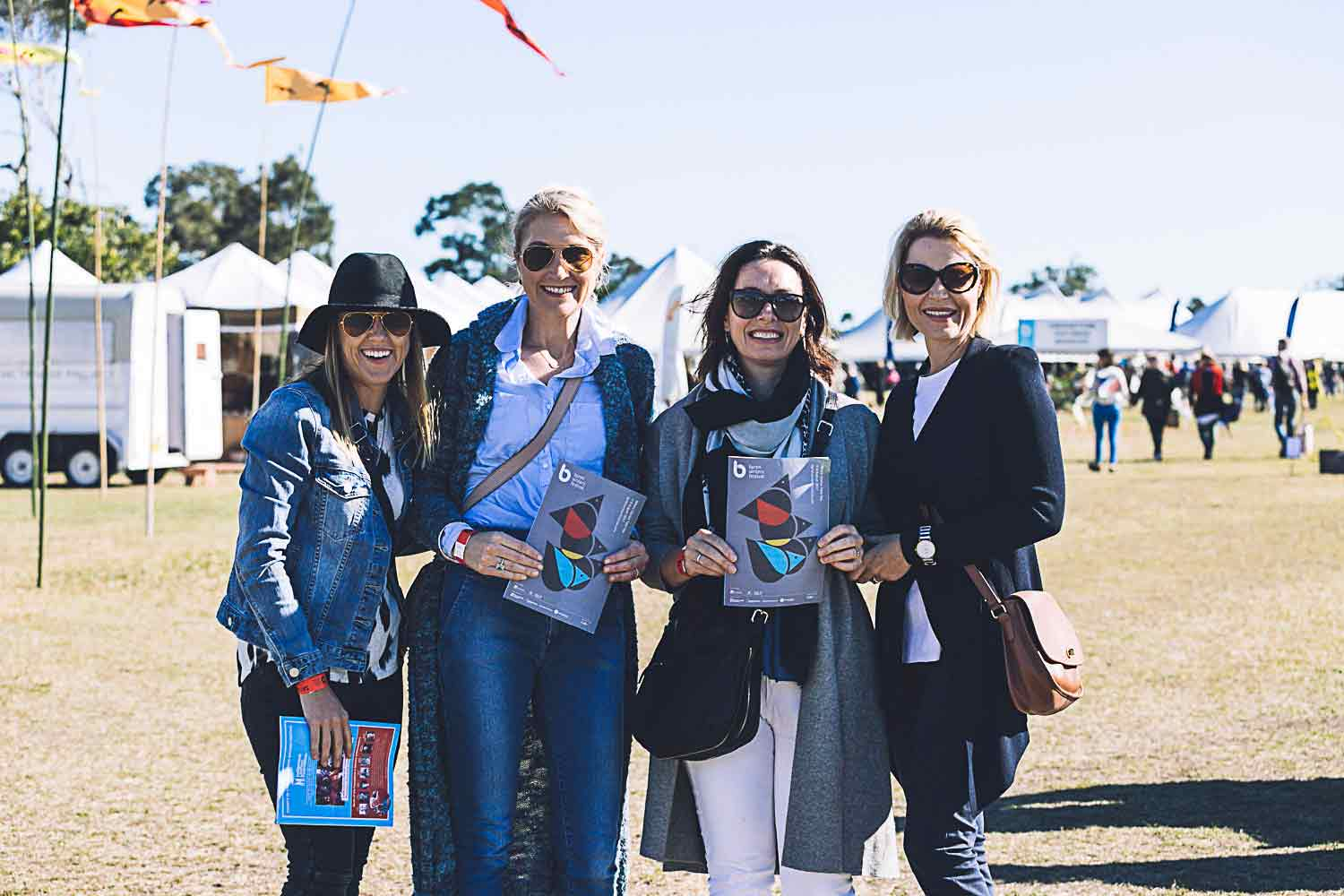 Happy group of female attendees at Byron Bay Festival 2017