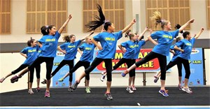 A group of kids doing aerobics in a Jump Jam event