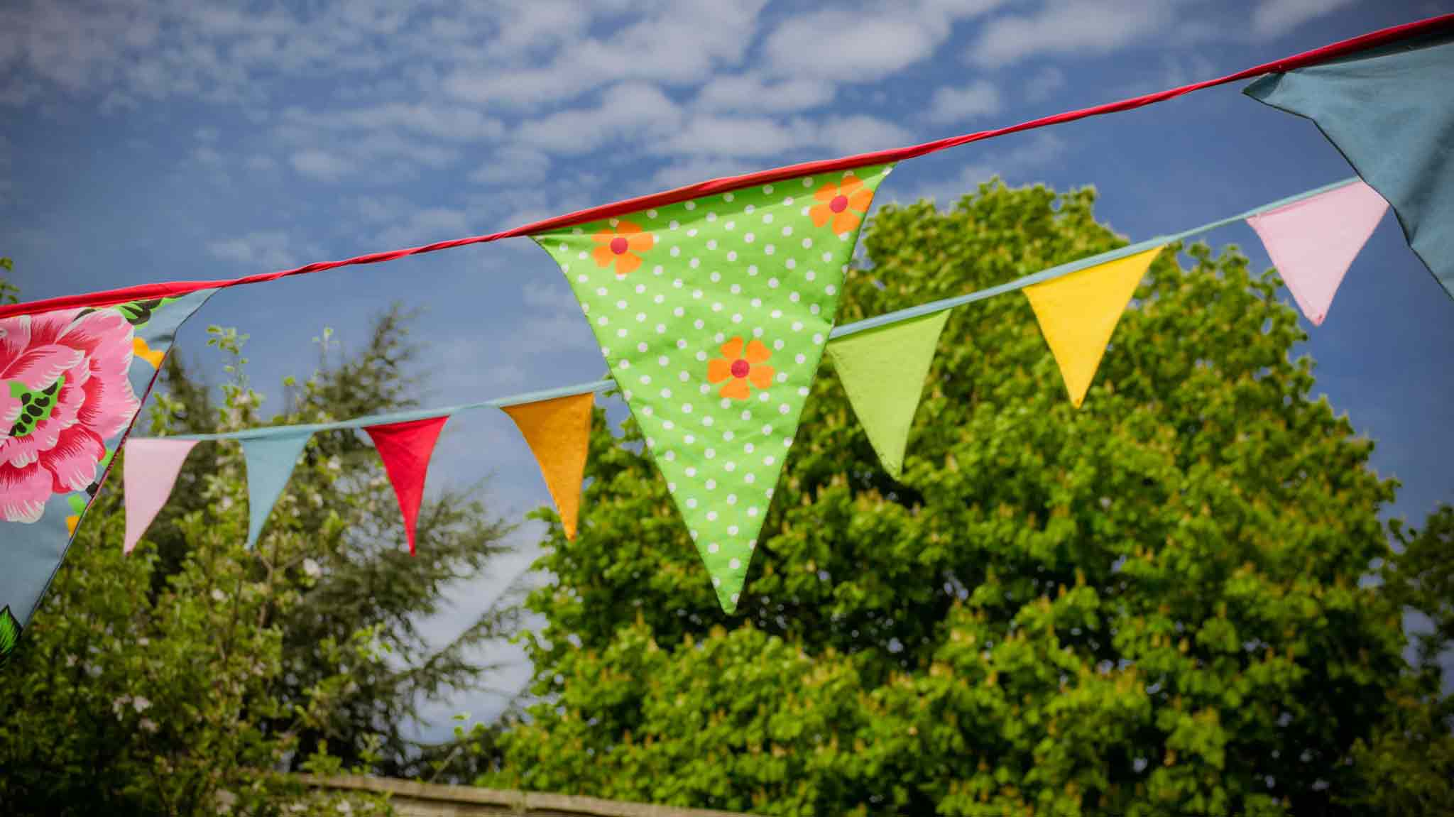 coloured bunting hung with clear blue skies behind